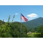 Young Harris: Old Glory with the beautiful mountains of Young Harris in the background!