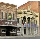 Mitchell: Historical Uptown Mitchell Main Street. Prairie Breeze Gallery on the left and former Mitchell National Bank on the right..