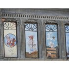 Arkansas City: East side of Summit Ave, murals painted on the main street buildings