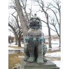 Sheridan: Oriental Lion Statue in park in Sheridan