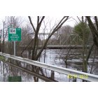 Taunton: 2010 Flood, view of Taunton River cresting under railroad on Route 44 on the Taunton, MA /Raynham MA town line....