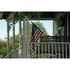 Leesburg: Flag on porch at Ida Lee Park Farmhouse in Leesburg